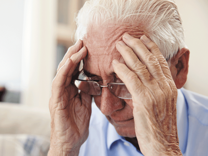 An elderly man looking depressed.