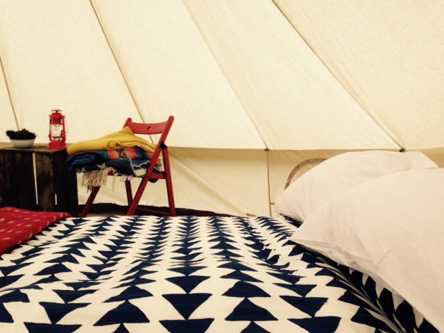 Bell-Tent-interior-Contemporary-arrow-duvet-camping lantern-vinatge-crate