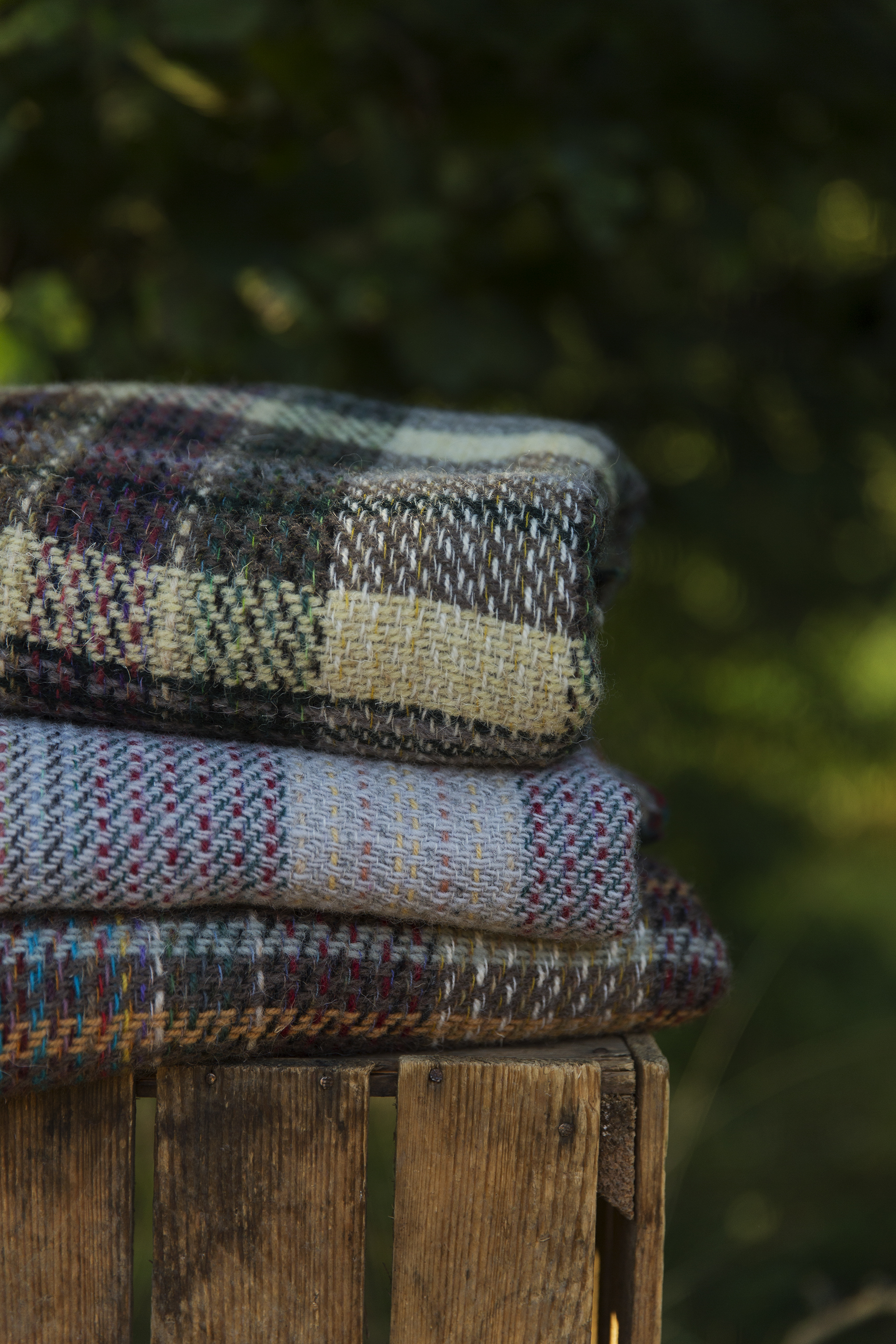 eco wool blankets on wooden apple crate