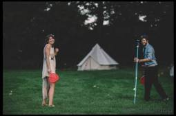 Guests-playing-games-at-bell-tent-wedding