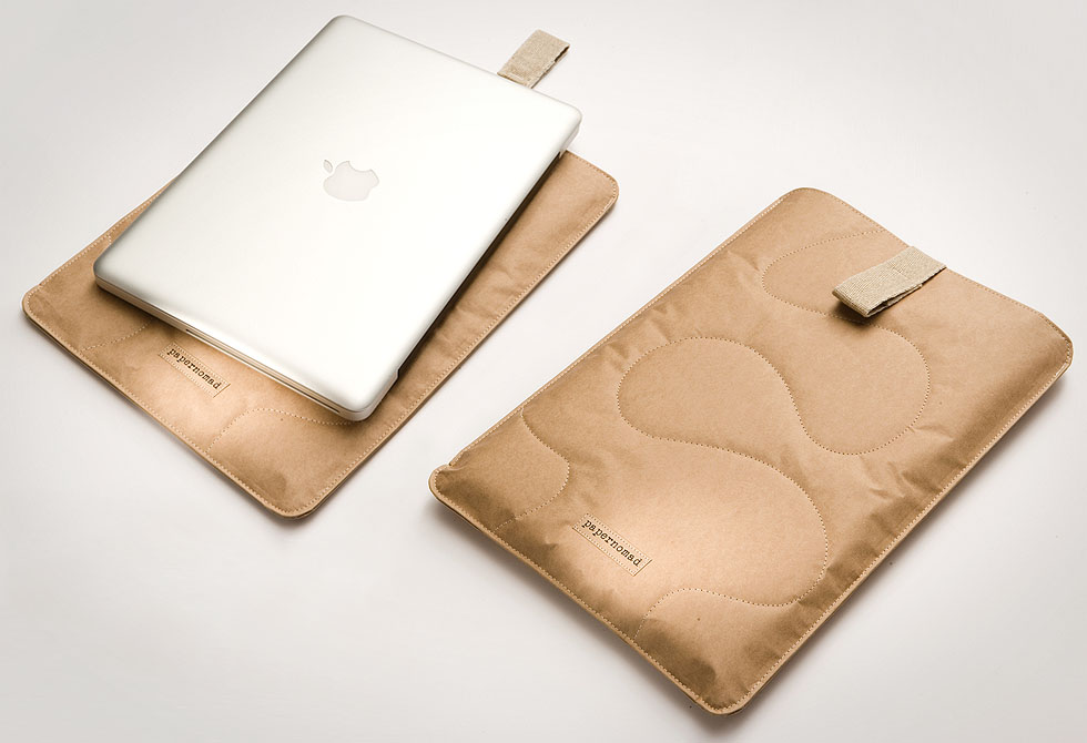 Laptop sitting on top of a Paper Nomad eco friendly laptop sleeve