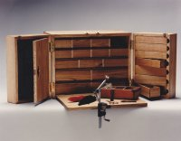 Fly tying cabinet with storage and folding work surface
