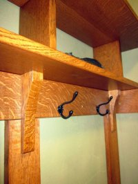 Built in coat rack, shelving, and drawers in entry way ...