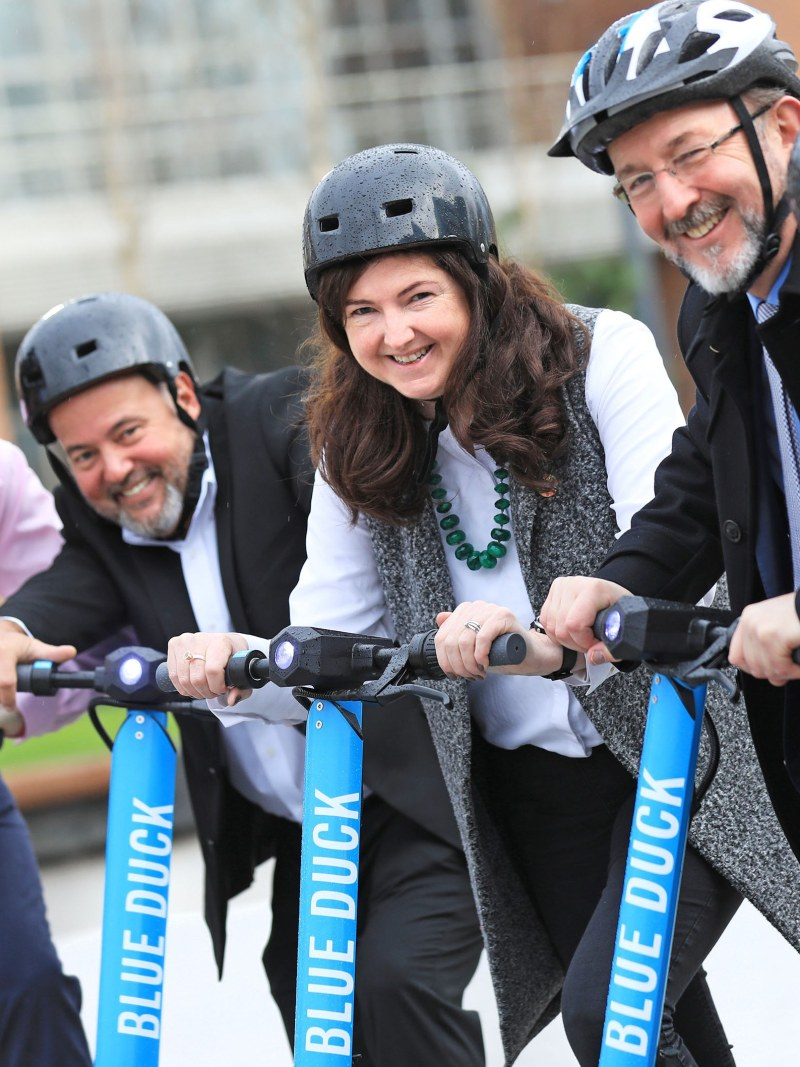10/12/19. NO FEE. NO REPRO FEE. JULIEN BEHAL PHOTOGRAPHY.  Picture shows l-r, Andrew Fleury, CEO, Luna; Peter Gomez, VP of Operations, Blue Duck Scooters; Samantha Fahy, DCU; Prof. Brian MacCraith, President of DCU and Ronan Quinlan, Co-CEO, Taoglas.  Irish Tech Consortium 'Luna', Partners with U.S. E-Scooter Operator Blue Duck, and Smart Dublin, To Pilot Its 'World First' Centimetre-Level Positioning Technology At Dublin City University.  JULIEN BEHAL PHOTOGRAPHY. NO FEE.