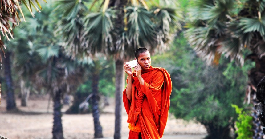 Monk with cell phone in Siem Reap Cambodia