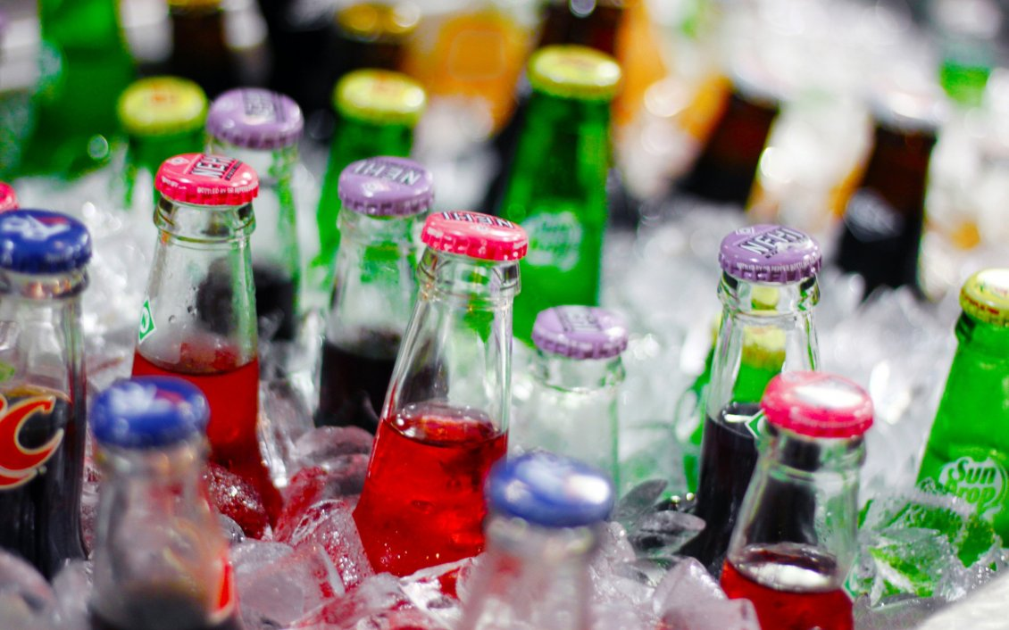 12331_Bottles-of-soda-in-the-ice-Fresh-drink-in-a-summer-hot-day