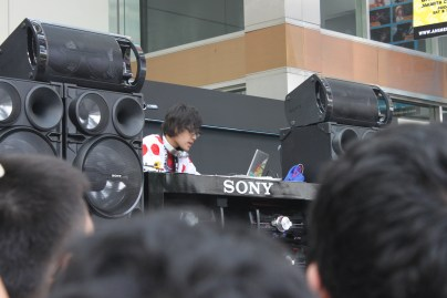 DJ Kazu, mixing music, blaring through the audience with Vocaloid songs!