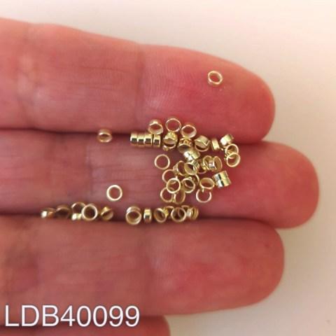 Mostacilla apretador bañada en oro 1gr 54un aprox