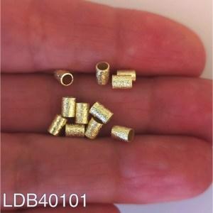 Mostacilla bañada en oro 1gr 11un aprox