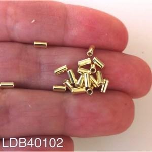 Mostacilla bañada en oro 1gr 18un aprox