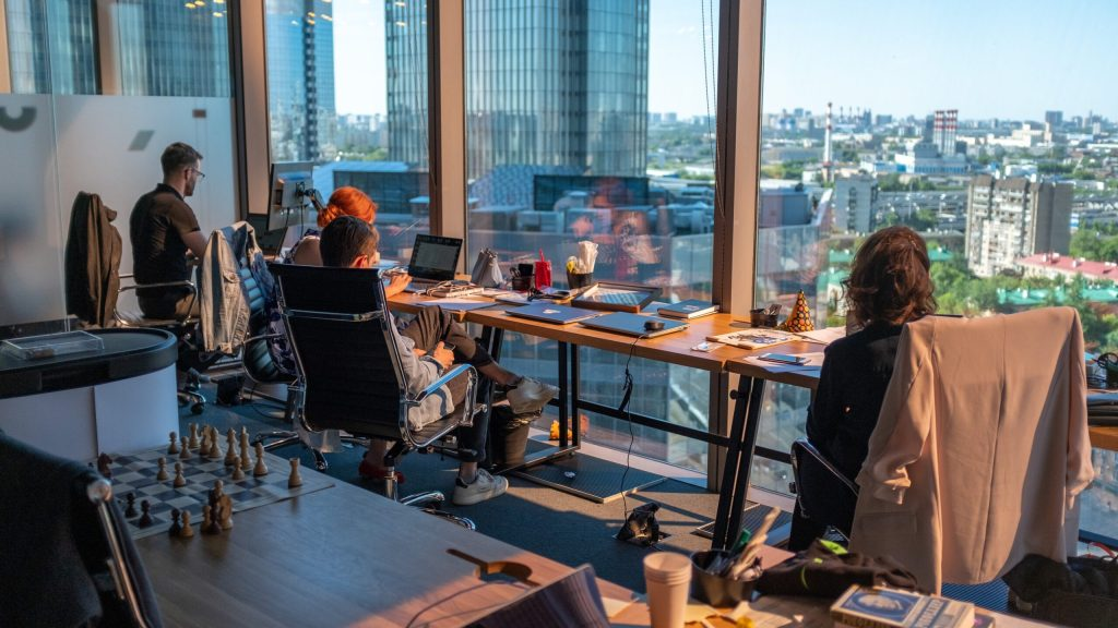 An office in a highrise with a view of the city with workers