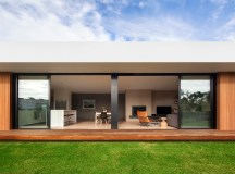 Timber and Glass Combine to Create a Stylish Coastal Modernity