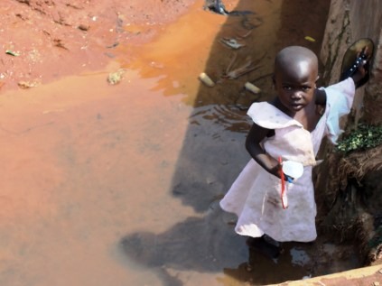 Resolve: girl brushing her teeth in this water