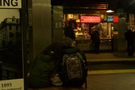 A couple waits for the MBTA.