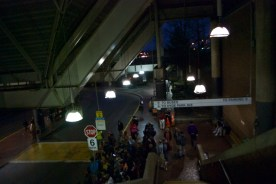 Boston residents wait for their bus home at Forest Hills Station.
