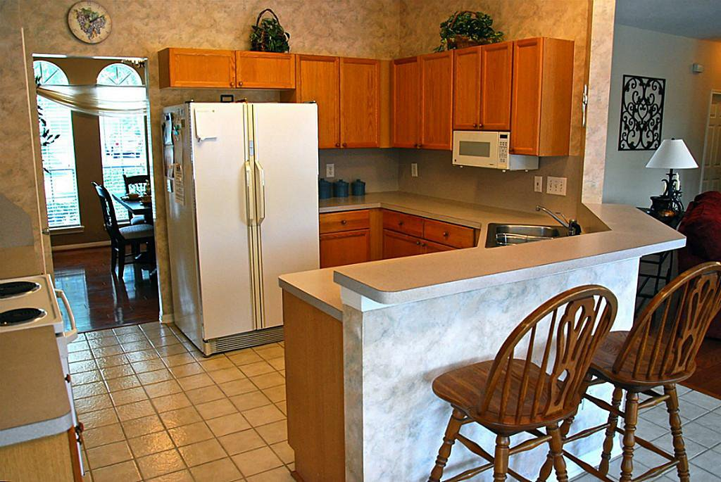 Buying a house with a dated kitchen allows you to save money and design a space that works for you and your family