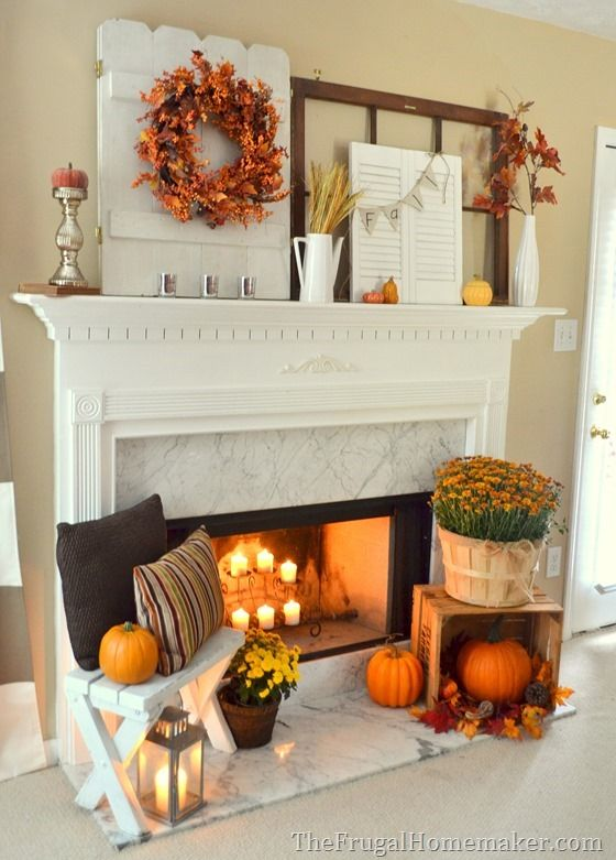 Decorate your mantle for fall with warm colors for a cozy rustic feel