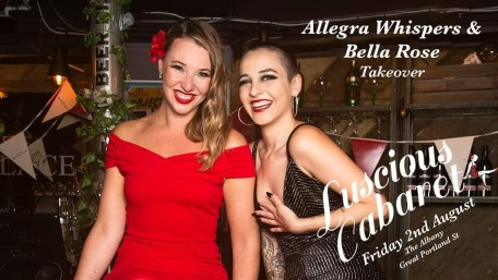two women smiling. One in a red dress with flower in her blonde hair and the other in black with a shaved head. With the words Allegra Whispers (woman in black) & Bella Rose (the woman in red) takeover Luscious Cabaret Friday 2nd August at The Albany Great Portland St