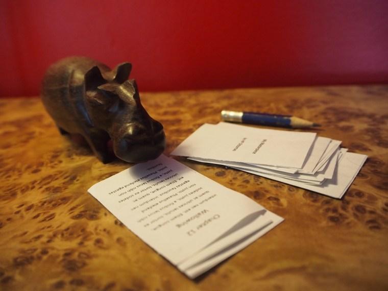 Little wooden hippo doing DIY manuscript appraisal