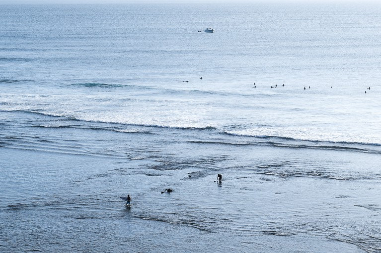 surfing uluwatu reef walk