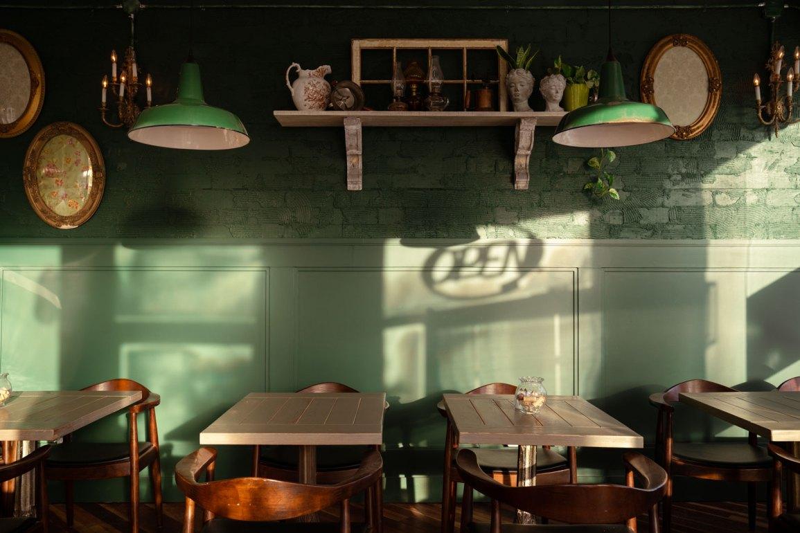 Green wall and open sign shadow at Mercado Negro
