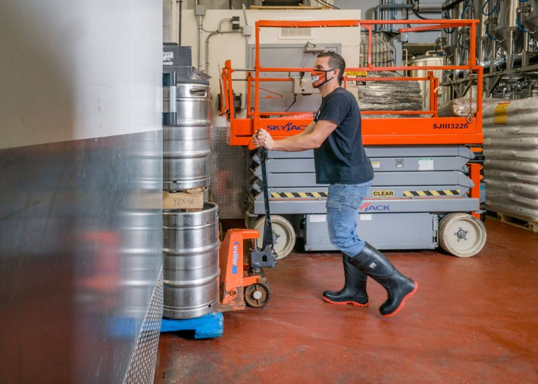man working at Brock Street Brewing Co