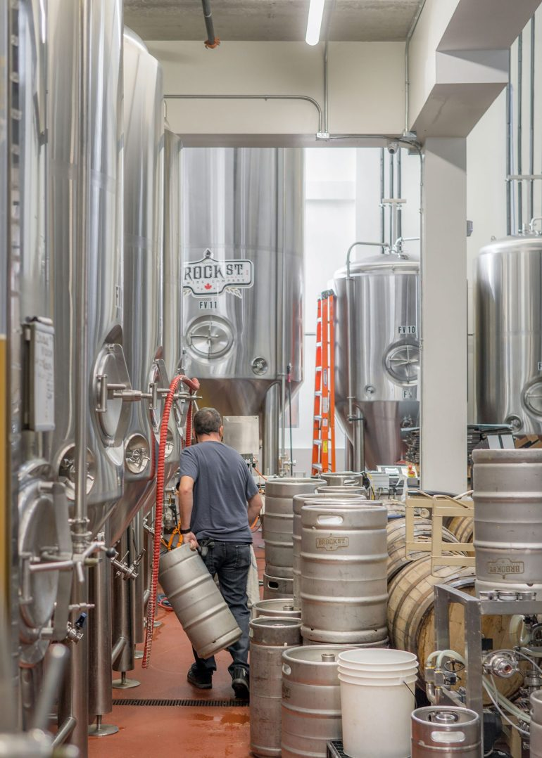Man working at Brock Street Brewing Co in Whitby