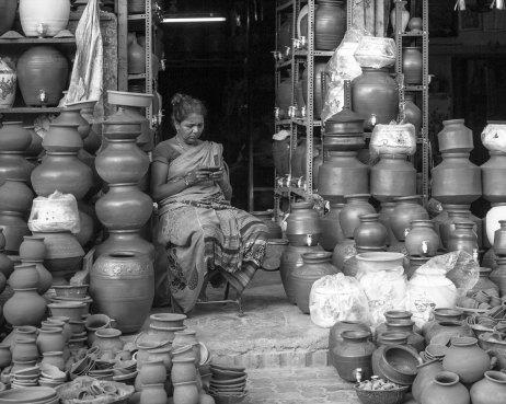 Lady at pottery market in Mumbai