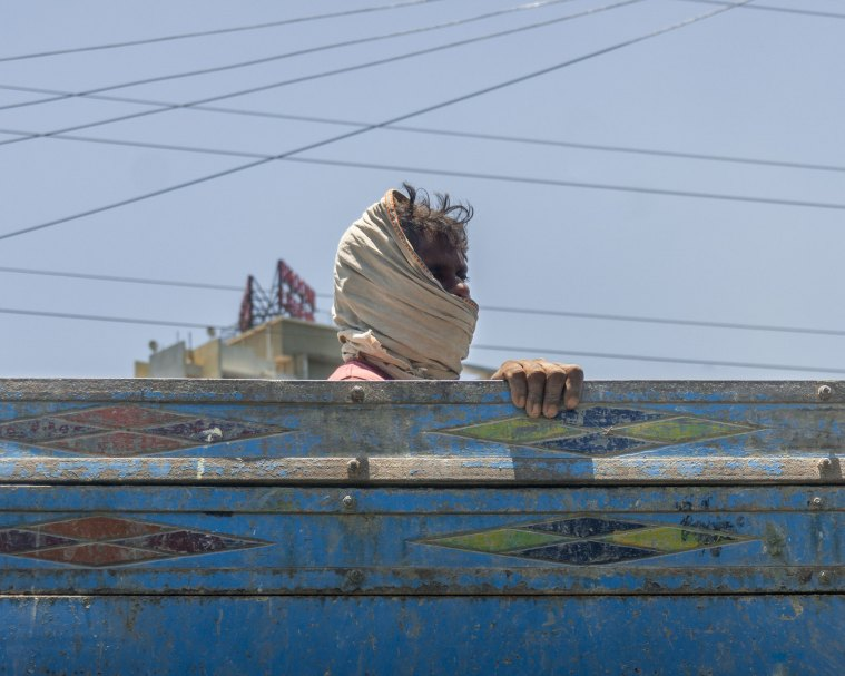 Man with head wrapped in Mumbai