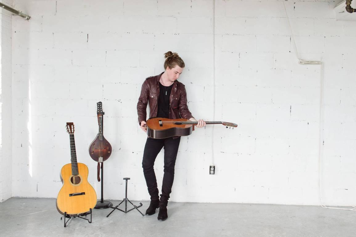 Tim Wilson holding guitar