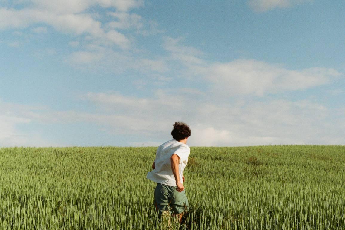 man running in Quebec field