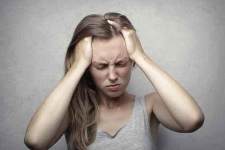 woman in gray tank top showing distress