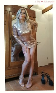 Cross dresser in shiny golden dress
