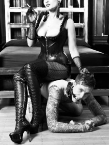 mistress sitting on a slave