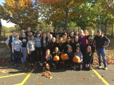 Women's team posing with their pumpkin trophies at the Charlie Brown Regatta in Portland, Oregon, October 24, 2015