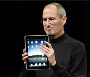 Steve Jobs holding forbidden iPad