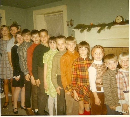 Peterson Cousins, enduring the Holiday indignities of scratchy clothes and being lined up by height