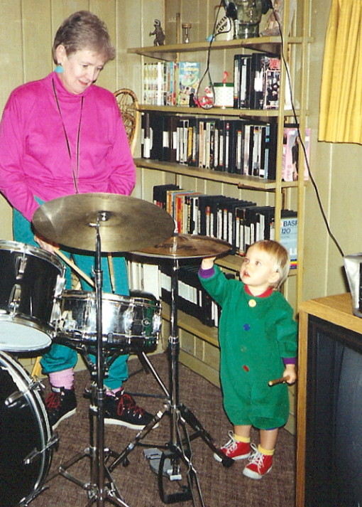 The Child shows my Mom how to play percussion (in Second Bro Roger's 'Cave'). It was during this visit that she pointed out Bill Clinton! Bill Clinton! on that TV to the right