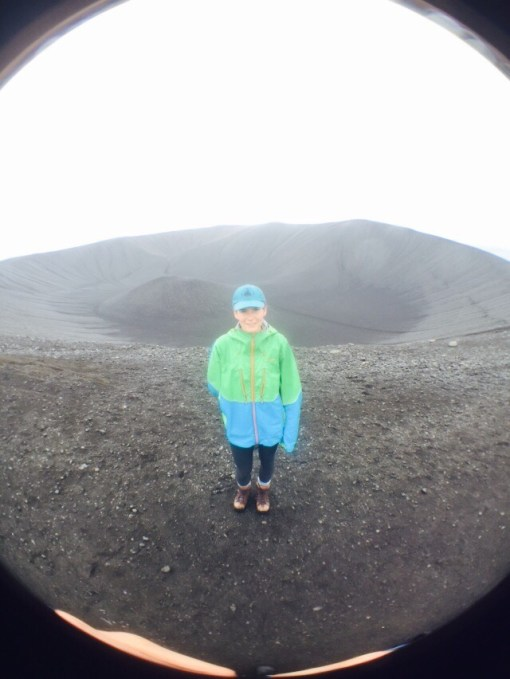 The Child in Iceland. Practicing her witchcraft? She's on the lip of a volcano, at any rate