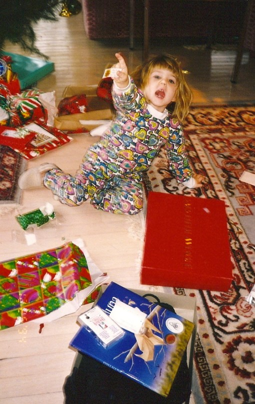 Small Child, huge pile of gifts