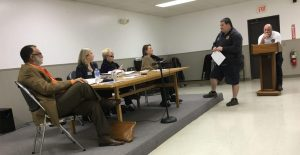 Brett Conner explains the particulars of AEDs to the town board.