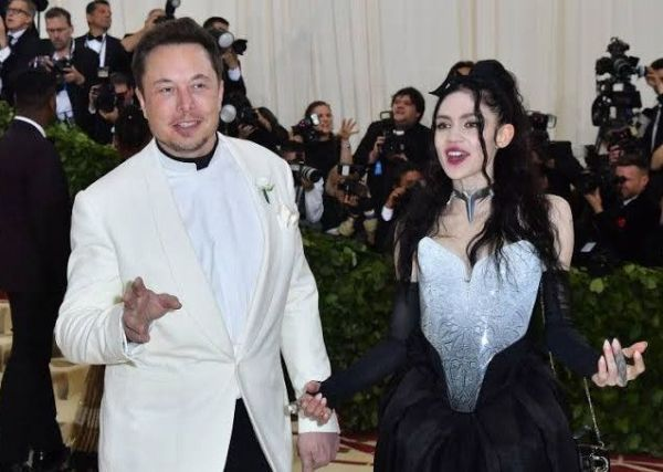 Amid Speculations She's Expecting A Child With Elon Musk, Grimes Releases A Photo Of Her Bare Baby Bump