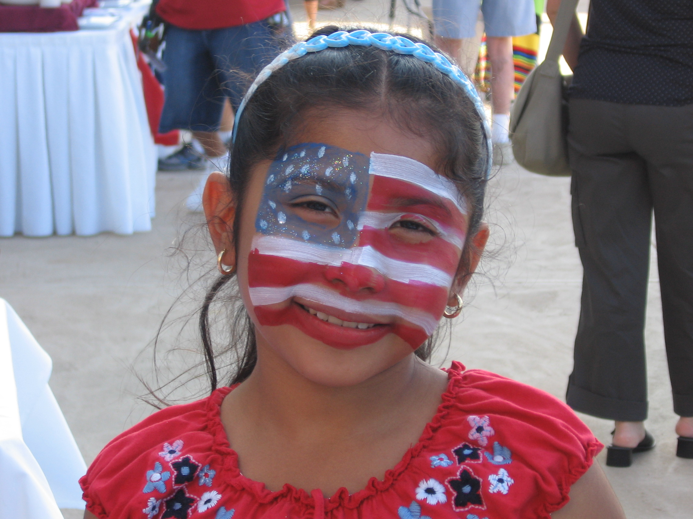 Patriotic little girl smiles!