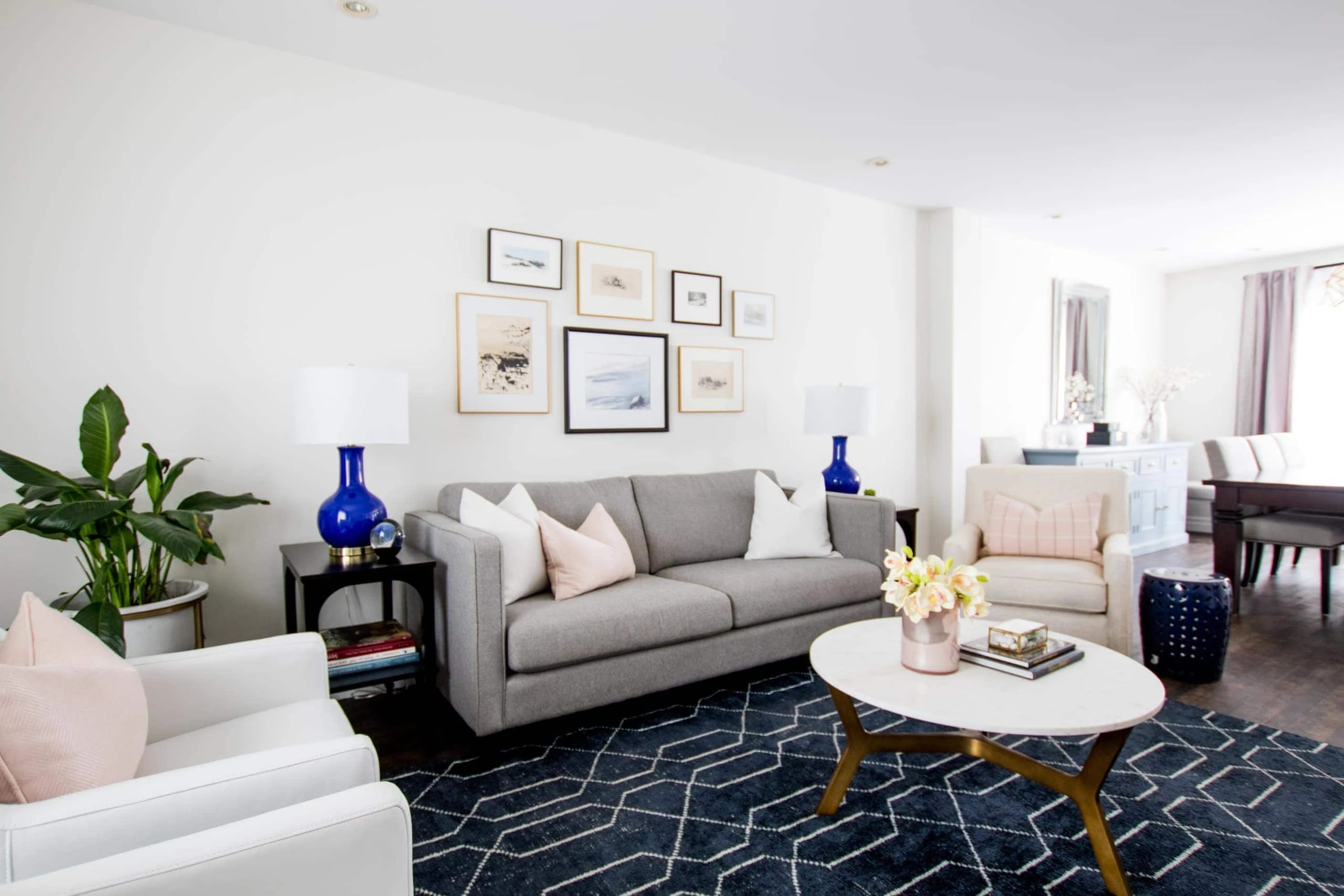 Bright living room with pictures above the couch