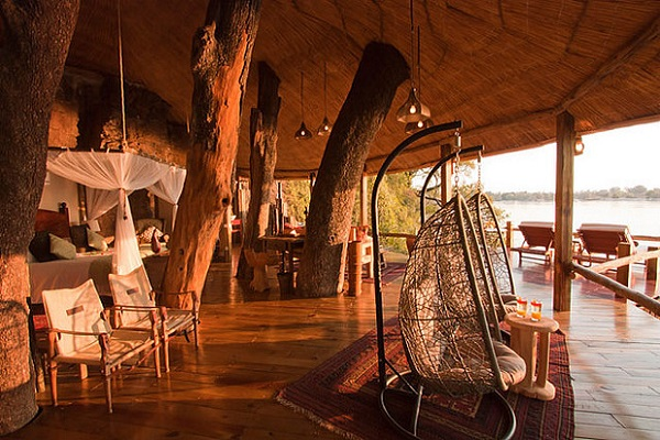 #1 Tongabezi Lodge's Tree House: Zambia Couples looking for a swoon-worthy stay should look at Tongabezi Lodge's newly rebuilt Tree House. A Zambian hideaway on the banks of the Zambezi River – just upstream of World Wonder Victoria Falls – the tree house is constructed around the branches of a riverine Ebony tree at the end of a hidden path. If the sensation of floating isn't from cloud nine, it may be because part of the tree house is suspended over the water. Romance in a nutshell is a perfectly positioned claw footed bath that affords views of the river while bathing: sunset, candles and flower petals.