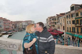 Kissing on the Rialto in Venice, Italy