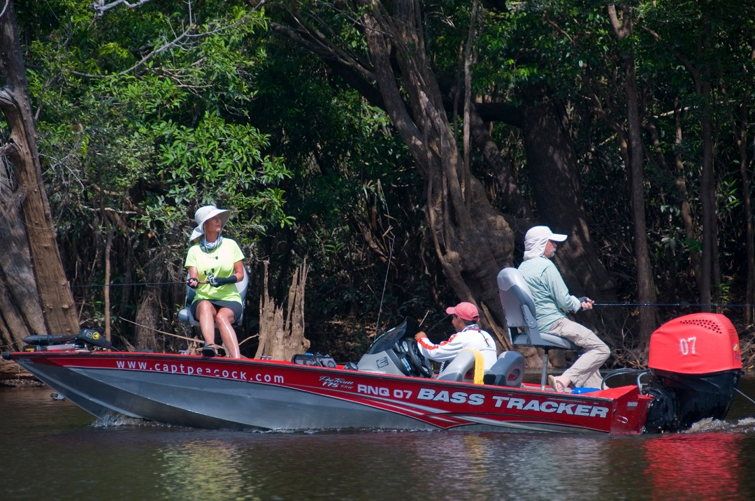 The comfortable bass boats with fore and aft casting decks are ideal for fishing Amazon waters. (photo by Larry Larsen)