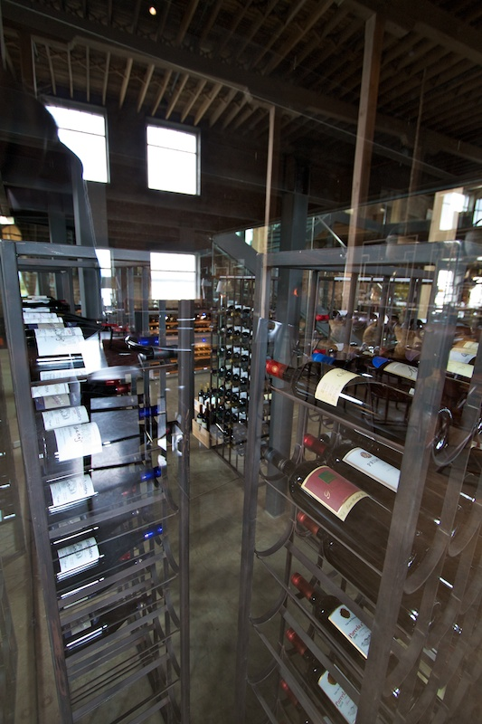 "A glass walled wine ""cellar"" sits under the stairwell"