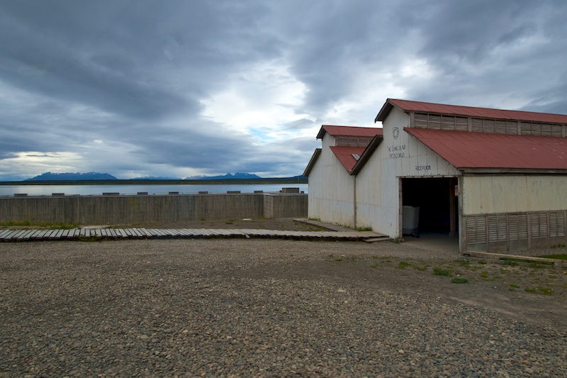 Visitors arrive at the property and enter a large storage shed that offers drive-in shelter from the weather