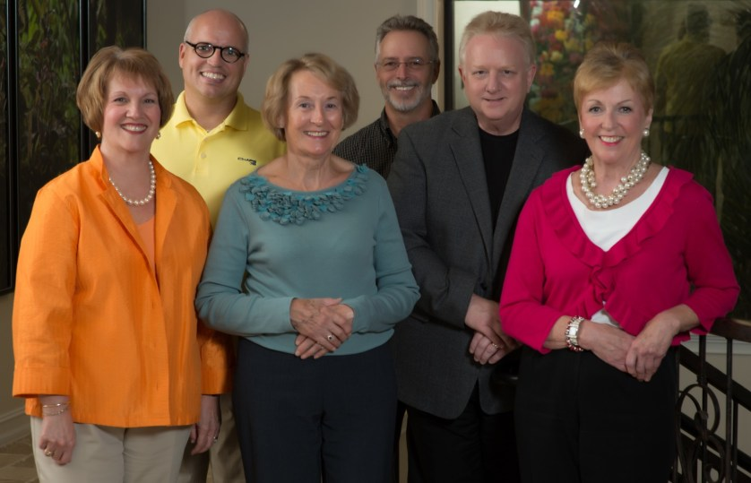 Naples Team - left to right—Betsy Patton (orange), Judith Stang (blue), Lois Moran (fuschia) Charles Wolfe (yellow), Ray Griggs (brown) and William (Mitch) Mitchell (Grey Sport coat). Courtesy of Hurley Travel Experts